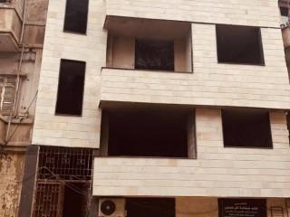 كتلة مكونة من ٤ طوابق